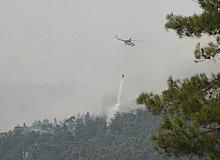 Köyceğiz yangınına 12 helikopter ve 2 uçak ile müdahale sürüyor